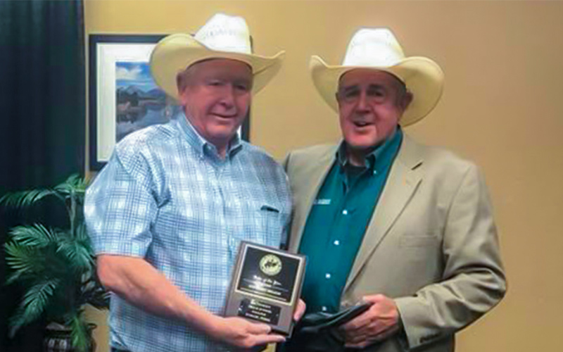 Photo: (l-r) SWTJC Rodeo Coach Roy Angermiller (left) accepts the award for Rodeo of the Year in the Southern Region from Roger Walters, (right) National Intercollegiate Rodeo Association Commissioner in Casper Wyoming.